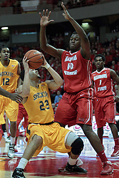 22 January 2014:  Fred VanVleet waits for John Jones to show his hand before approaching the basket during an NCAA Missouri Valley Conference mens basketball game between the Shockers of Wichita Stat and the Illinois State Redbirds  in Redbird Arena, Normal IL.