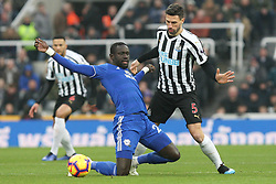 January 19, 2019 - Newcastle, England, United Kingdom - Cardiff City's Oumar Niasse contests for the ball with Newcastle United's Fabian Schar during the Premier League match between Newcastle United and Cardiff City at St. James's Park, Newcastle on Saturday 19th January 2019. (Credit Image: © Mark Fletcher/NurPhoto via ZUMA Press)