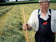 Portrait of William Woods, hill farmer, working in the hayfield, Bilsdale, North York Moors, North Yorkshire, UK