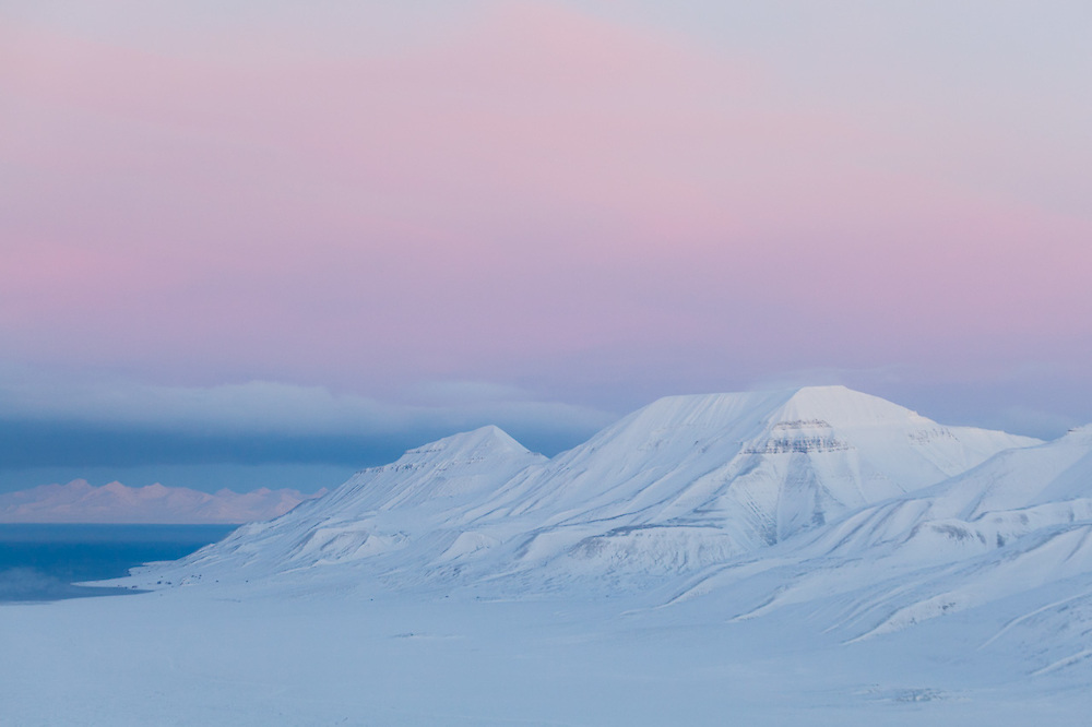View of Adventdalen, Hiorthfjellet and Adventtoppen, and out Adventfjorden at dawn from Breinosa, Svalbard.