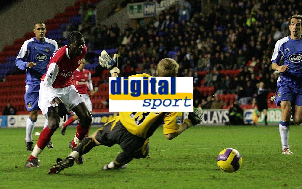Photo: Paul Thomas.<br /> Wigan Athletic v Arsenal. The Barclays Premiership. 13/12/2006.<br /> <br /> Emmanuel Adebayor scores for Arsenal.