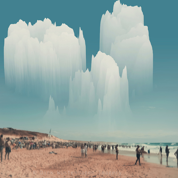 Surreal beach scene with towering clouds - distorted and manipulated photographs