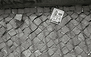 Berlin GERMANY  Cobbled pavement with flyer for 26th April and cigarette butts  on The Oranienburger Str. Berlin-Mitte. Tuesday    20/04/2010  [Mandatory Credit. Peter Spurrier/Intersport Images] Street Photos