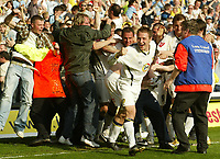 Photo: Aidan Ellis.<br /> Leeds United v Plymouth Argyle. Coca Cola Championship. 07/04/2007.<br /> leeds Ian Moore (center) leads the celebrations with the fans after Lobomir Michalik's late winner