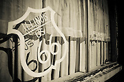 A Route 66 sign painted on a window in Atlanta, Illinois. Missoula Photographer
