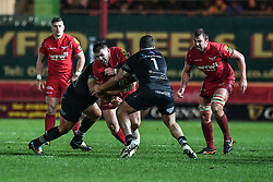 Scarlets' Rob Evans is tackled by Ospreys' Dimitri Arhip and Nicky Smith - Mandatory by-line: Craig Thomas/Replay images - 26/12/2017 - RUGBY - Parc y Scarlets - Llanelli, Wales - Scarlets v Ospreys - Guinness Pro 14