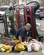 Middletown firefighter Joe Myers talks to a man injured in a two-car accident at the intersection of North Street and Prospect Street in Middletown at about 10:45 a.m. on April 25, 2007.