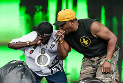 © Licensed to London News Pictures. 26/08/2012.  London, UK.  Flavour Flav (L) and Chuck D (Right) of Public Enemy live at South West Four/SW4 on Clapham Common during the August Bank Holiday Weekend.  Photo credit : Richard Isaac/LNP