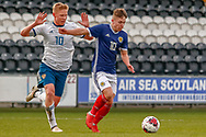 Scotland's Kai Kennedy (Rangers FC) under pressure form Andrei Savinov during the U17 European Championships match between Scotland and Russia at Simple Digital Arena, Paisley, Scotland on 23 March 2019.