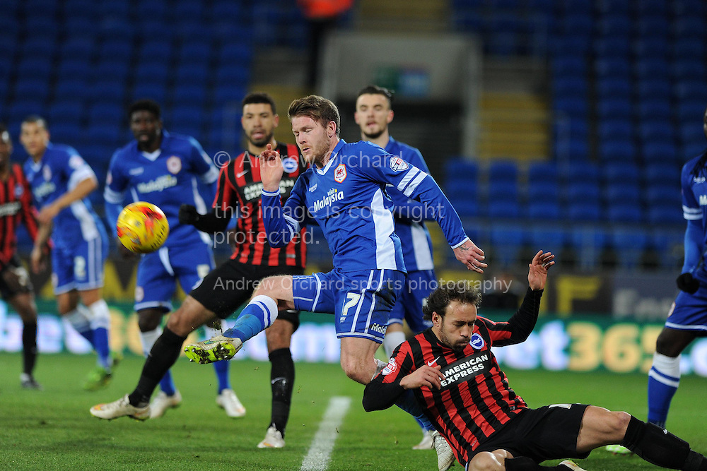 Cardiff city's Aron Gunnarsson © holds off Brighton's Inigo Calderon (r).Skybet football league championship match, Cardiff city v Brighton & Hove Albion at the Cardiff city Stadium in Cardiff, South Wales on Tuesday 10th Feb 2015.<br /> pic by Andrew Orchard, Andrew Orchard sports photography.