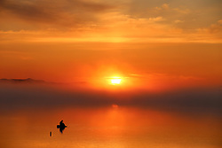 June 16, 2017 - Raohe, China -  A lone fisherman in the wetland scenery amongst the morning mist along the Wusuli River in northeast China's Heilongjiang Province. (Credit Image: © Xu Congjun/Xinhua via ZUMA Wire)