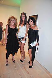 Left to right, KELLY HOPPEN, LAUREN BUDD (Model name Violet Budd) and NANCY DELL'OLIO at an exhibition of photographic portraits by Bryan Adams entitled 'Hear The World' at The Saatchi Gallery, King's Road, London on 21st July 2009.