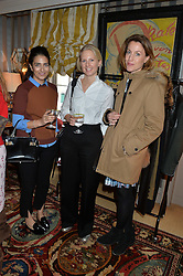Left to right, NURA KHAN, GEORGINA BLACKWELL and EMILY GOAD at a ladies lunch hosted by Katie Readman for sisters Lucia & Rosie Ruck Keene founders of a new fashion label - Troy, held at 5 Hertford Street, London on 27th January 2015.