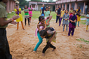 Tabasum Khatun, 14, and her best friend Anju Kumari, 13, (left) are practising a Karate counter-attack move during a class in Algunda village, pop. 1000, Giridih District, rural Jharkhand, India.