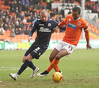 Blackpool's Nathan Delfouneso in action with Millwall's Alan Dunne<br /> <br /> Photographer Mick Walker/CameraSport<br /> <br /> Football - The Football League Sky Bet Championship - Blackpool v Millwall - Saturday 10th January 2015 - Bloomfield Road - Blackpool <br /> <br /> © CameraSport - 43 Linden Ave. Countesthorpe. Leicester. England. LE8 5PG - Tel: +44 (0) 116 277 4147 - admin@camerasport.com - www.camerasport.com