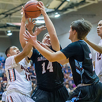 Gallup Bengal Joaquin Ortega (30), left, Sandia Prep Sundevil Jacob Montoya (14)  fight for possession as Sundevil Max Feit (20) and Bengal Asa Holyan (42) look on during the Bengal Boys Basketball Invitational Tournament at Gallup High School Friday.