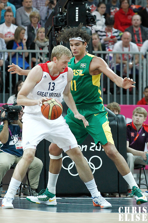 31 July 2012: Brazil Anderson Varejao defends on Great Britain Dan Clark during 67-62 Team Brazil victory over Team Great Britain, during the men's basketball preliminary, at the Basketball Arena, in London, Great Britain.