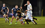 Sale Sharks wing Marland Yarde is tackled by  Saracens wing Liam Williams during the Aviva Premiership match Sale Sharks -V- Saracens at The AJ Bell Stadium, Salford, Greater Manchester, England on Friday, February 16, 2018. (Steve Flynn/Image of Sport)