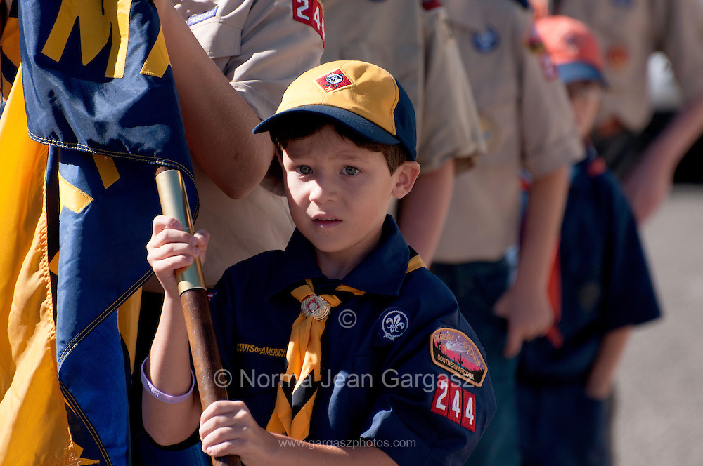 Members of the Boy Scouts of America march in the Veterans Day Parade, which honors American military veterans, in Tucson, Arizona, USA.