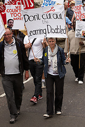 © licensed to London News Pictures. LONDON, UK  11/05/2011. Thousands of disabled people march past Parliament to protest against cuts to the support offered to the physically and mentally handicapped in particular the disability living allowance (DLA). Please see special instructions for usage rates. Photo credit should read CLIFF HIDE/LNP
