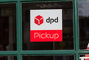 Sign for DPD Pickup, High Street, Marlborough, Wiltshire, England, UK