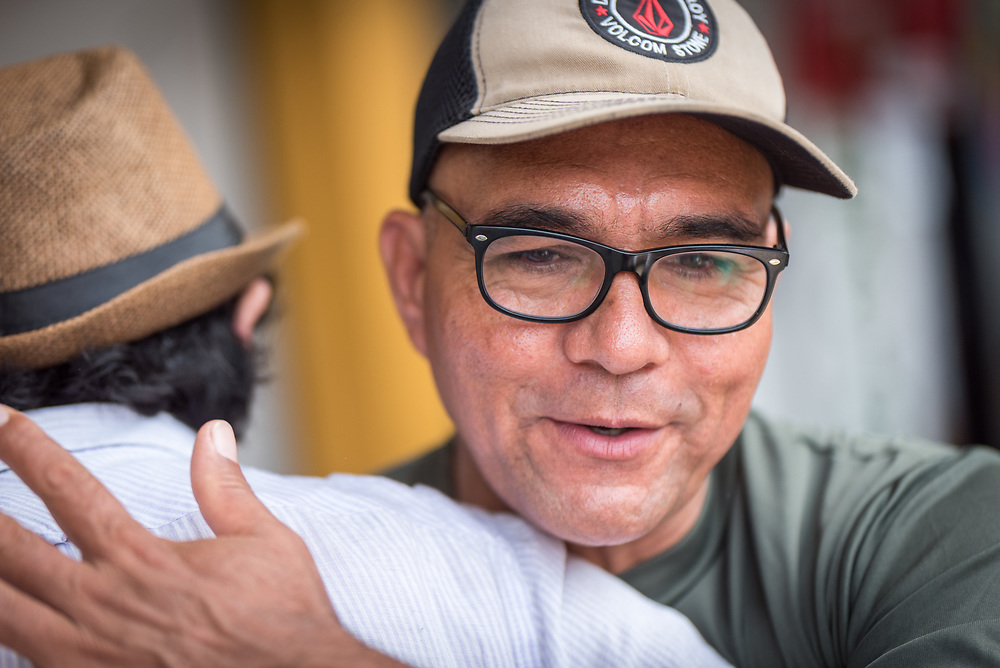 """17 November 2018, Dabeiba, Antioquia, Colombia: """"Harrison"""", the name by which he is known as a former commander in the Armed Revolutionary Forces of Colombia (FARC) is one of many ex-combatants currently trying to reconstruct their lives peacefully in Colombian civil society, following the 2016 peace treaty between the FARC Guerilla and the Colombian government. Challenges remain, however, as armed groups remain active in northwest Colombia, a strategically important corridor for trade into Central America, and ex-combatants face both stigma, threats of assassination, and suffer from a lack of fulfilment by the government on transfering ownership of lands to former guerilla combatants, which leads both to vulnerability and instability for life in the countryside. The Evangelical Lutheran Church of Colombia accompanies communities of ex-combatants, as well as the communities into which they are reintegrating, to help alleviate the risk of re-victimization or relapse into violent conflict. Here, Harrison greets Rev. John Hernández, a Lutheran pastor who accompanies said communities."""