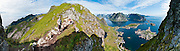Above the Arctic Circle, ascend a steep and slippery trail to Reinebringen for spectacular views of sharply glaciated peaks surrounding Reinefjord, on Moskenesøya (the Moskenes Island), Lofoten archipelago, Nordland county, Norway. Panorama stitched from 11 overlapping photos.