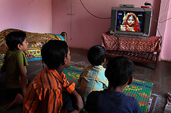 Children watch Balika Vadhu, a television show that highlights child marriage, in Rajasthan, India on April 30, 2009.
