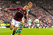 Sean Clare of Hearts wins the ball ahead of Celtic's Kristoffer Ajer during the William Hill Scottish Cup Final match between Heart of Midlothian and Celtic at Hampden Park, Glasgow, United Kingdom on 25 May 2019.