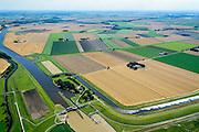 Nederland, Groningen, Oldambt,  05-08-2014; Nieuwe Statenzijl, gelegen op de grens met de Reiderwolderpolder. Sluizencomplex met spuisluis en schutsluis. Via de Westerwoldse Aa kan water op de Dollard geloosd worden<br /> Watermanagement complex with locks and sluice on the border with Germany. Used for discharging water into the Dollard<br /> <br /> luchtfoto (toeslag op standard tarieven);<br /> aerial photo (additional fee required);<br /> copyright foto/photo Siebe Swart