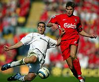 Fotball<br /> Premier League 2004/05<br /> Liverpool v Bolton<br /> 2. april 2005<br /> Foto: Digitalsport<br /> NORWAY ONLY<br /> Steven Gerrard of Liverpool is tackled by Tal Ben Haim of Bolton.