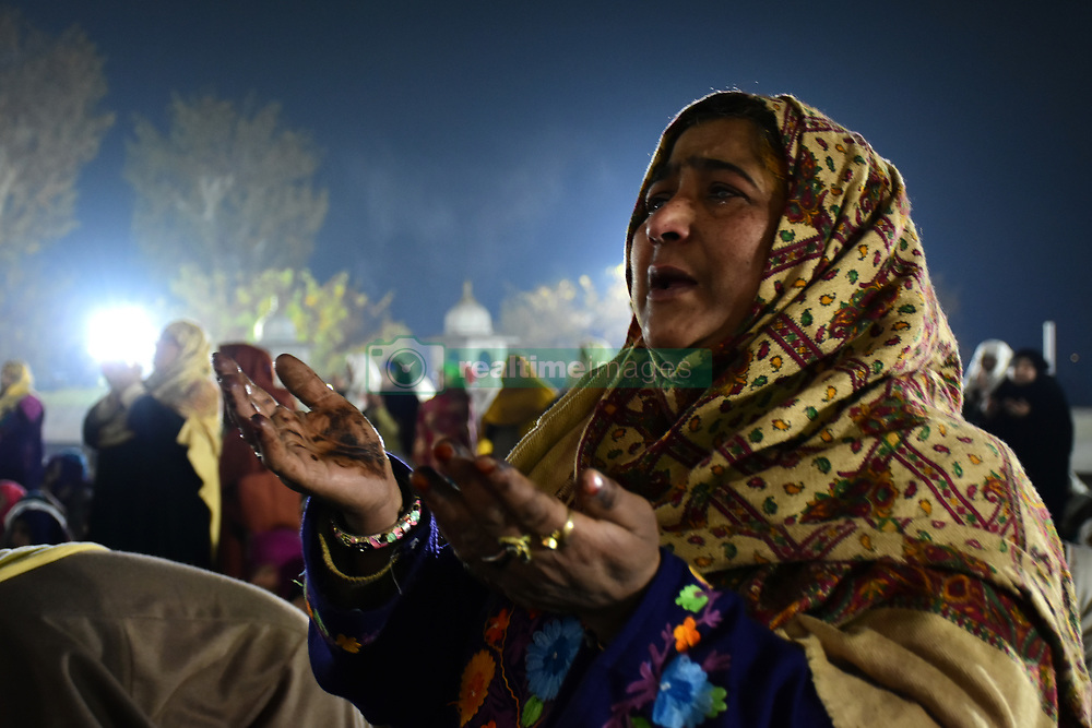 November 21, 2018 - Srinagar, Jammu and Kashmir, India - Kashmiri Muslims pray on the day Prophet Muhammad PBUH'S birthday at Hazratbal Shrine in Srinagar. Few sects of muslims celebrate the prophets birthday and offer special prayers throughout the day. (Credit Image: © Muzamil Mattoo/Pacific Press via ZUMA Wire)