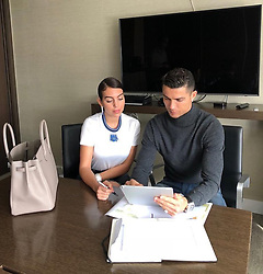 """Cristiano Ronaldo releases a photo on Instagram with the following caption: """"Business day \ud83d\ude09\u2764\ufe0f"""". Photo Credit: Instagram *** No USA Distribution *** For Editorial Use Only *** Not to be Published in Books or Photo Books ***  Please note: Fees charged by the agency are for the agency's services only, and do not, nor are they intended to, convey to the user any ownership of Copyright or License in the material. The agency does not claim any ownership including but not limited to Copyright or License in the attached material. By publishing this material you expressly agree to indemnify and to hold the agency and its directors, shareholders and employees harmless from any loss, claims, damages, demands, expenses (including legal fees), or any causes of action or allegation against the agency arising out of or connected in any way with publication of the material."""
