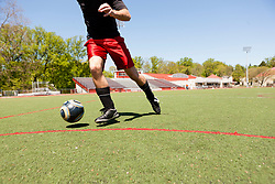 Soccer player running down pitch with ball (Credit Image: © Image Source/ZUMAPRESS.com)