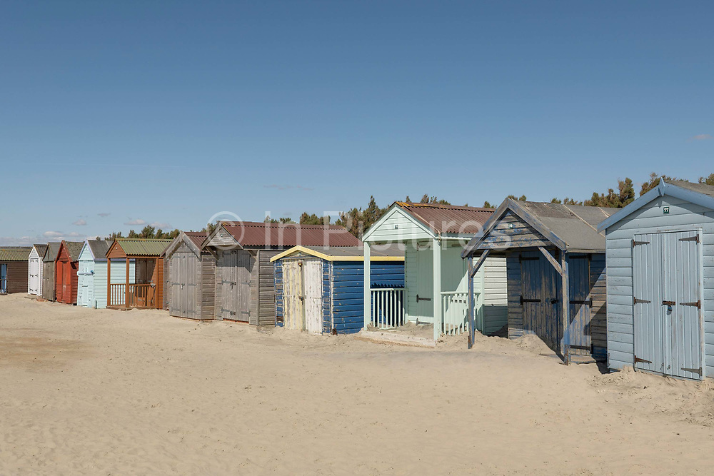 A row of colourful beach huts on the 8th September in West Wittering in the United Kingdom.