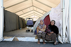October 5, 2016 - Athens, Greece - Women outside a tent in the olympic complex at the former Athens airport  of Athens, Greece on October 5, 2016.Almost 2,500 migrants and refugees, mainly Afghani, are housed at the former Athens airport site, and to an olympic complex used in the 2004 Olympics. In total 60.736 refugees and other migrants are stranded in Greece. (Credit Image: © Panayiotis Tzamaros/NurPhoto via ZUMA Press)