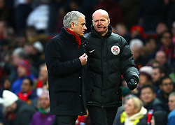 Manchester United manager Jose Mourinho (left) talks to the forth official at half time