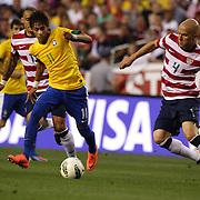 Neymar, Brazil, (left) is challenged by Michael Bradley, USA, during the USA V Brazil International friendly soccer match at FedEx Field, Washington DC, USA. 30th May 2012. Photo Tim Clayton