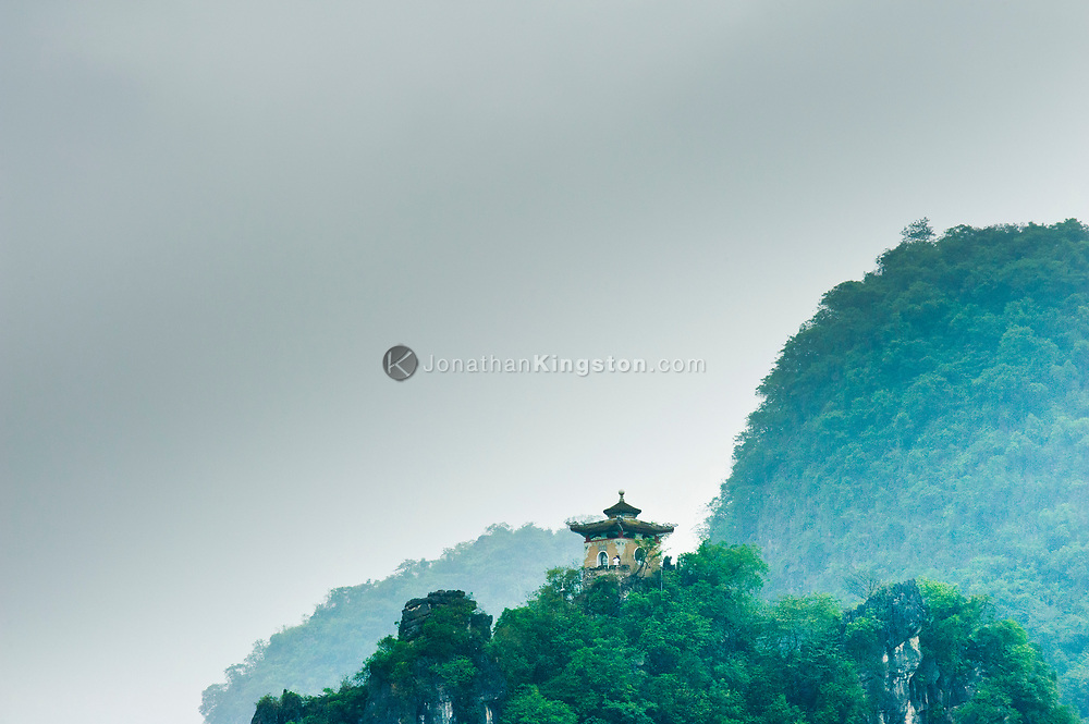 Low angle view of a pagoda built on top of a Karst formation in Yangshuo, China.