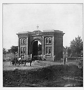 The gate to the local cemetery of Gettysburg, Pennsylvania from the book ' The Civil war through the camera ' hundreds of vivid photographs actually taken in Civil war times, sixteen reproductions in color of famous war paintings. The new text history by Henry W. Elson. A. complete illustrated history of the Civil war