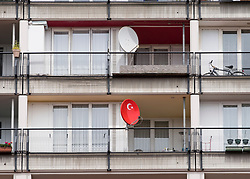 Turkish flag on satellite dish at social housing apartment block at Pallasseum on Pallastrasse in Schoeneberg district of Berlin, Germany.