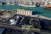 Nederland, Zuid-Holland, Rotterdam, 18-02-2015; Eerste Maasvlakte met aan de Amazonehaven Europees Massagoed Overslagbedrijf (EMO). Gespecialiseerd in de overslag van kolen en ijzererts.<br /> In de achtergrond de containerterminal APM Terminals.<br /> EMO transhipment terminal for coal and iron ore and other dry bulk.<br /> luchtfoto (toeslag op standard tarieven);<br /> aerial photo (additional fee required);<br /> copyright foto/photo Siebe Swart