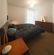 Modern bedroom with bedside tables. Modern apartment. Nobody inside