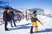 Tourists watch skiers at Beldersay ski resort on 27th February 2014 in Uzbekistan.