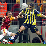 Galatasaray's Yekta KURTULUS (L) and Fenerbahce's Andre Clarindo Dos SANTOS (R) during their Turkish superleague soccer derby match Galatasaray between Fenerbahce at the Turk Telekom Arena in Istanbul Turkey on Friday, 18 March 2011. Photo by TURKPIX
