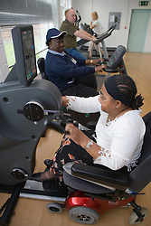 Group of Service users from a day centre enjoying a gym session,