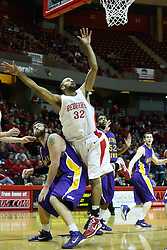 12 January 2011: Lucas O'Rear undercuts a rebound attempt by Jackie Carmichael during an NCAA Missouri Valley Conference men's basketball game between the Northern Iowa Panthers and the Illinois State Redbirds at Redbird Arena in Normal Illinois.