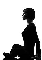 woman yoga sukhasana pose posture position in silouhette on studio white background