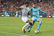 Manchester United Forward Marcus Rashford takes on Barcelona Gerard Pique during the International Champions Cup match between Barcelona and Manchester United at FedEx Field, Landover, United States on 26 July 2017.
