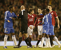 Photo: Aidan Ellis.<br /> Manchester United v Chelsea. The Barclays Premiership. 26/11/2006.<br /> Tempers flare after a challenge by Didier Drogba on United's Nemanja Vidic